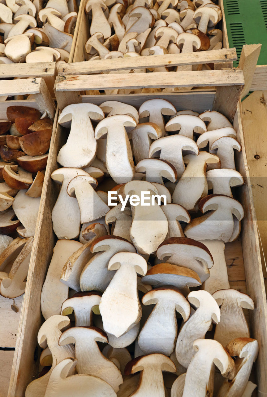 High Angle View Of Mushrooms In Wooden Crates At Market