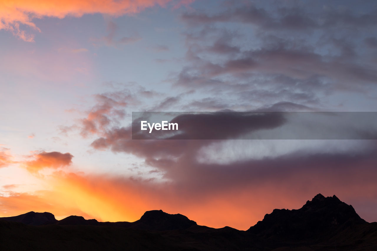 sky, cloud - sky, sunset, beauty in nature, scenics - nature, mountain, orange color, tranquil scene, tranquility, silhouette, no people, nature, idyllic, non-urban scene, mountain range, dramatic sky, low angle view, environment, outdoors, mountain peak