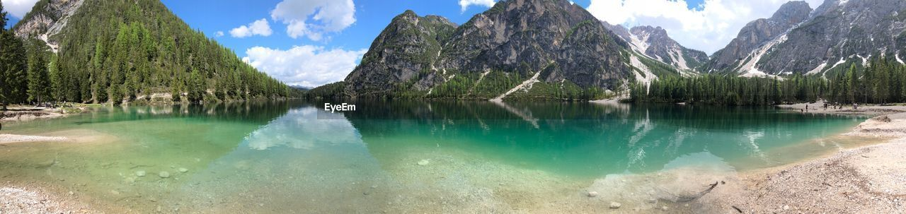 water, beauty in nature, scenics - nature, mountain, tranquil scene, tranquility, reflection, sky, non-urban scene, nature, lake, idyllic, day, cloud - sky, panoramic, mountain range, tree, plant, no people, outdoors, turquoise colored