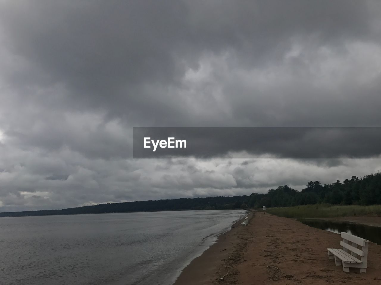 cloud - sky, sky, scenics, nature, tranquil scene, tranquility, weather, water, storm cloud, landscape, beauty in nature, sea, beach, day, sand, no people, outdoors, tree, thunderstorm