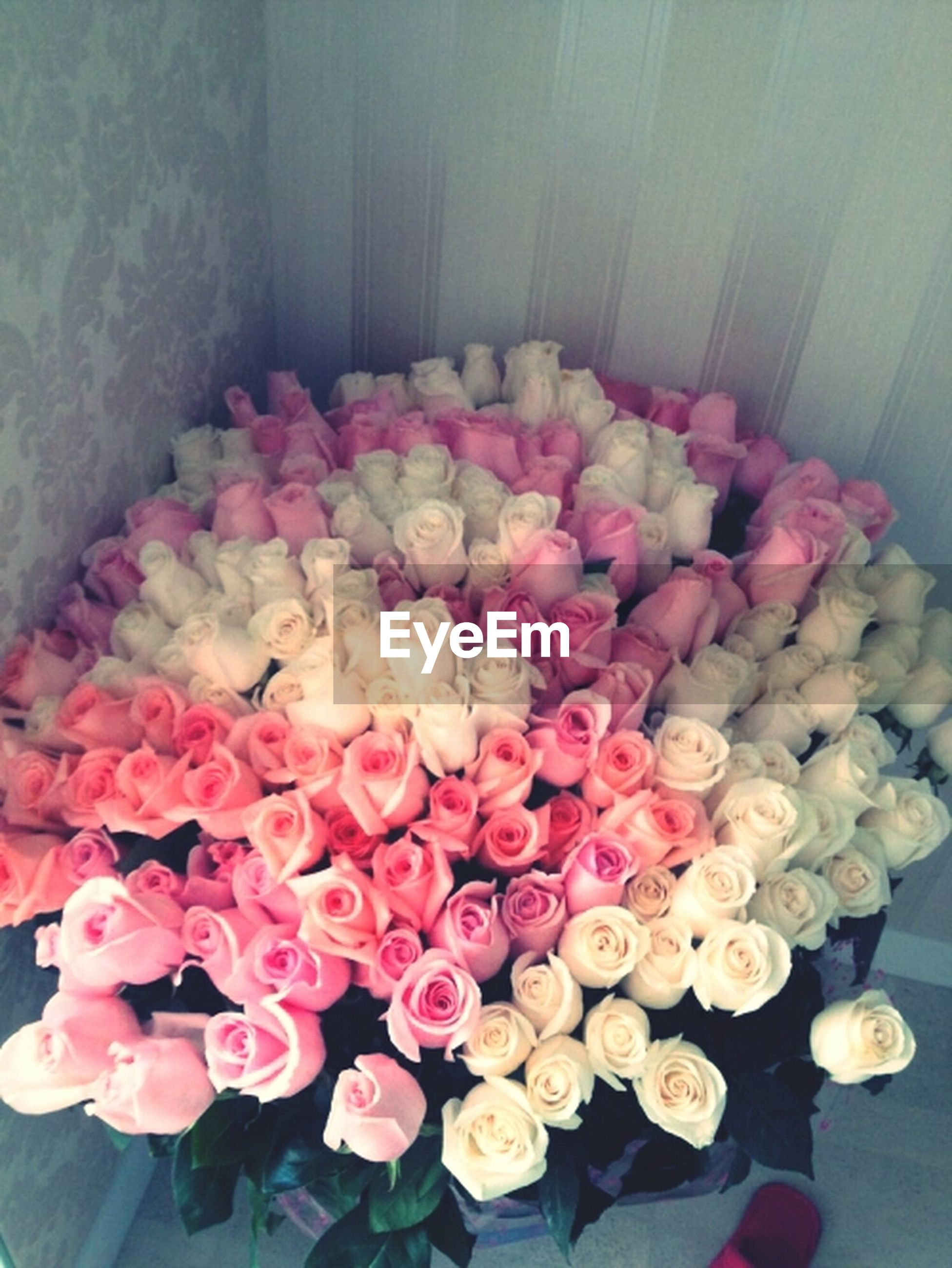 indoors, flower, freshness, fragility, petal, multi colored, decoration, high angle view, pink color, variation, table, bouquet, flower head, still life, vase, close-up, abundance, bunch of flowers, red, no people