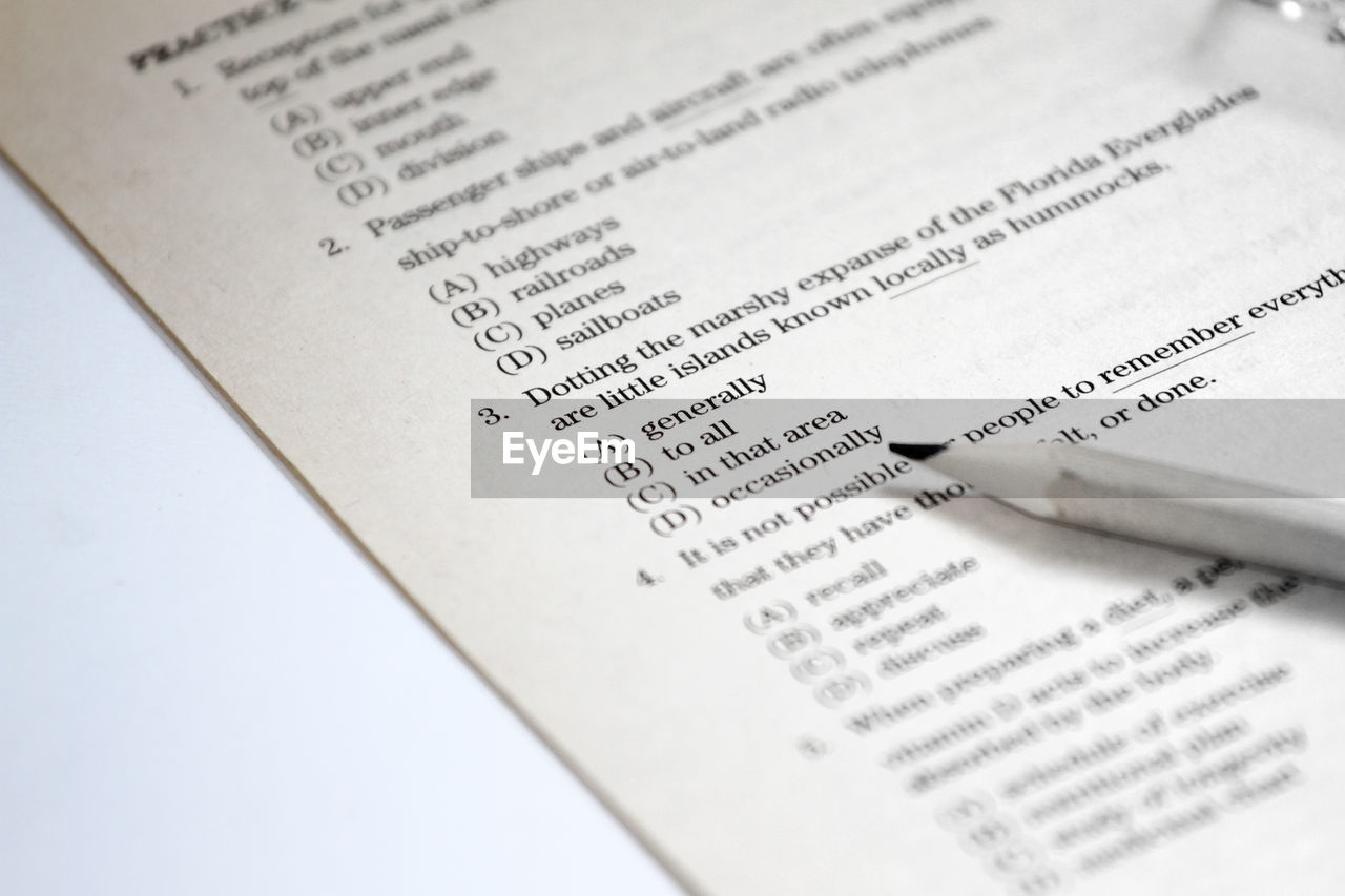 text, communication, western script, paper, education, close-up, no people, selective focus, indoors, document, still life, page, publication, number, high angle view, book, full frame, non-western script, learning, textbook, message