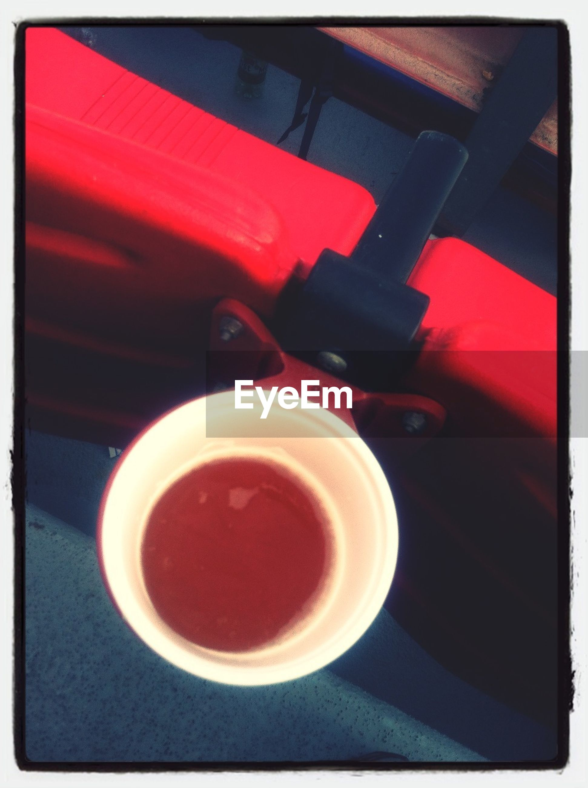 transfer print, indoors, auto post production filter, table, red, high angle view, still life, drink, food and drink, coffee cup, cup, close-up, coffee - drink, coffee, refreshment, saucer, no people, spoon, directly above, wood - material