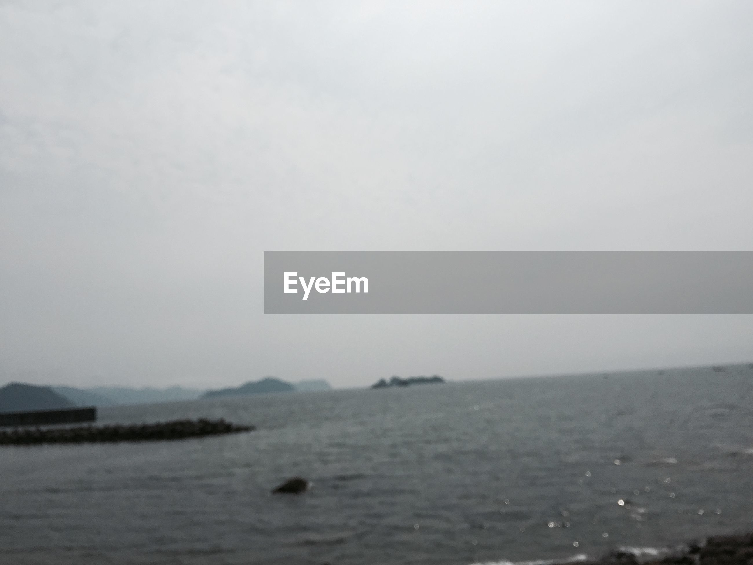 water, tranquil scene, tranquility, fog, scenics, beauty in nature, copy space, waterfront, nature, sea, foggy, mountain, sky, lake, idyllic, landscape, river, non-urban scene, outdoors