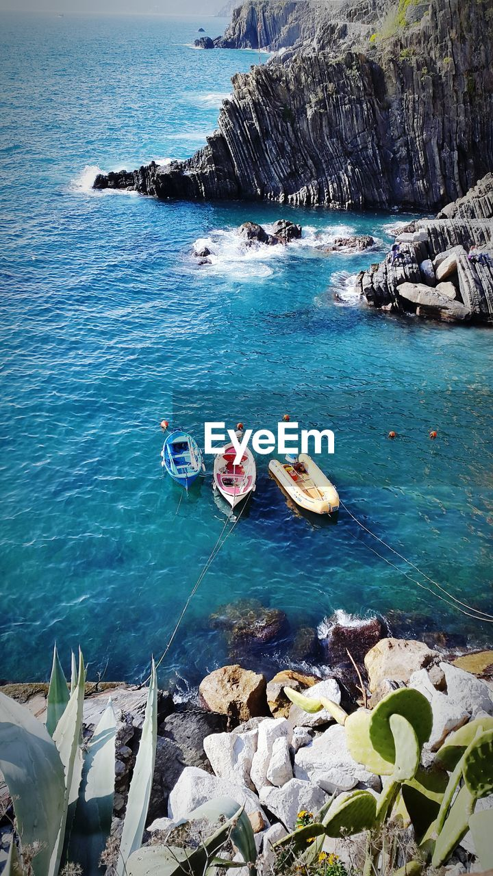 high angle view, sea, water, transportation, rock - object, blue, day, nautical vessel, mode of transport, nature, no people, outdoors, scenics, beauty in nature, sky