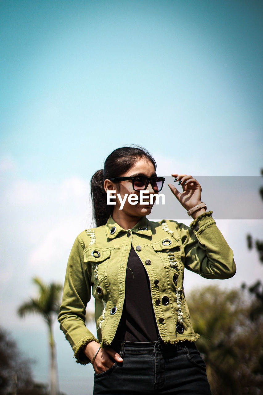 Fashionable woman wearing eyeglasses looking away outdoors