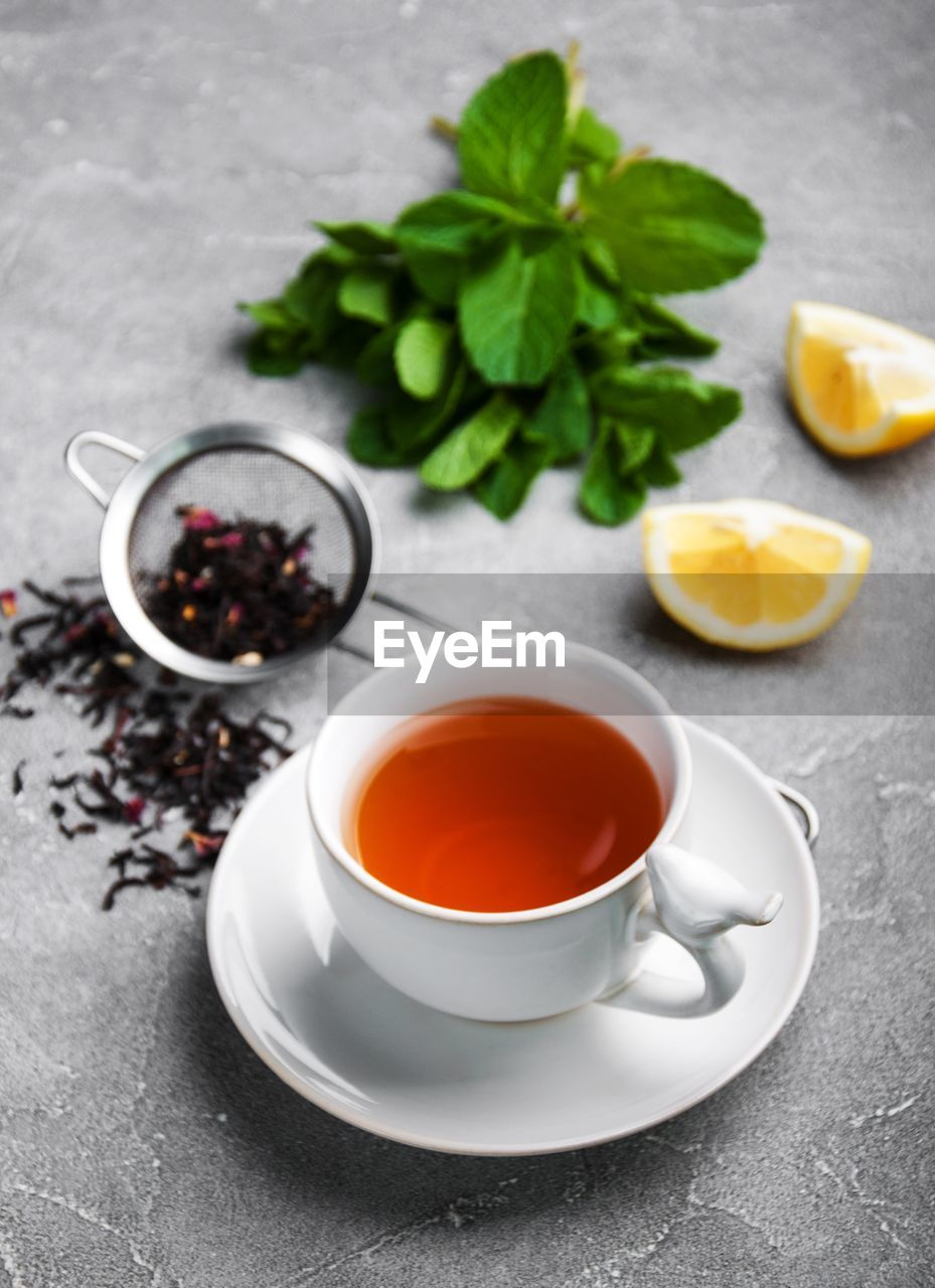 food and drink, food, refreshment, drink, freshness, citrus fruit, cup, tea, table, healthy eating, tea - hot drink, fruit, hot drink, mug, leaf, tea cup, lemon, wellbeing, no people, saucer, crockery, herb, mint leaf - culinary, non-alcoholic beverage, black tea