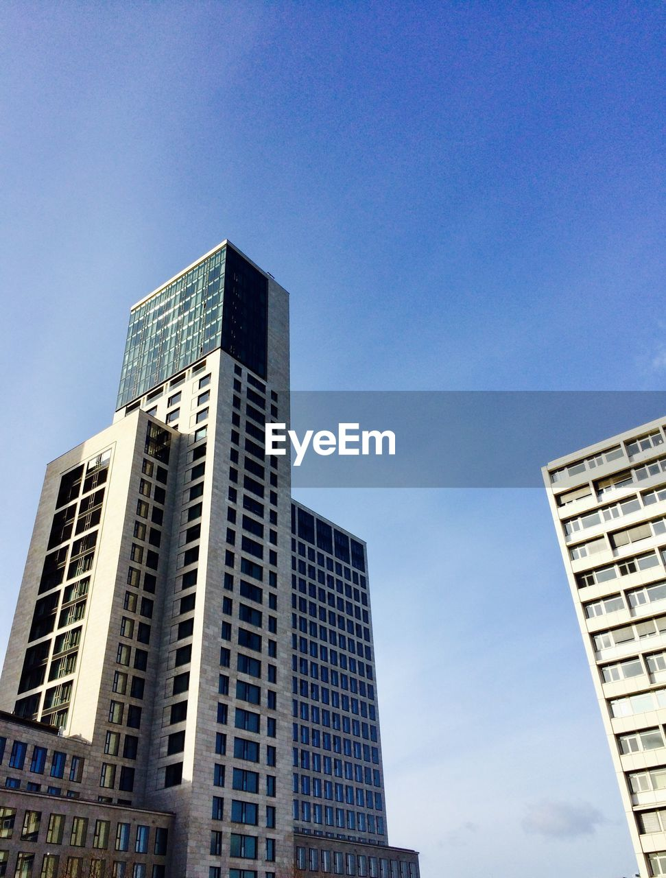 architecture, low angle view, skyscraper, modern, building exterior, city, built structure, no people, outdoors, day, clear sky, blue, tall, sky, cityscape