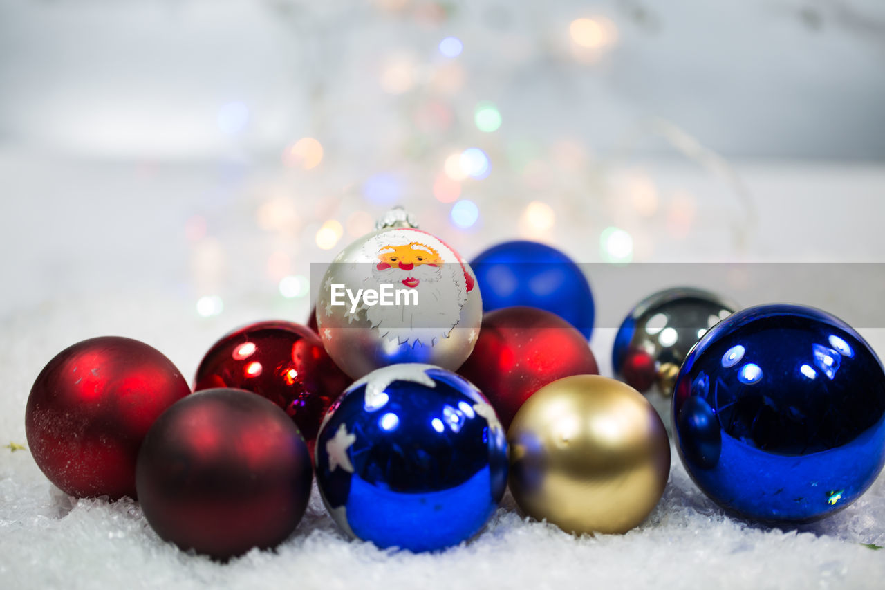 sphere, multi colored, ball, close-up, no people, indoors, still life, holiday, selective focus, celebration, shiny, table, shape, marble, large group of objects, christmas, christmas decoration, christmas ornament, focus on foreground, snow