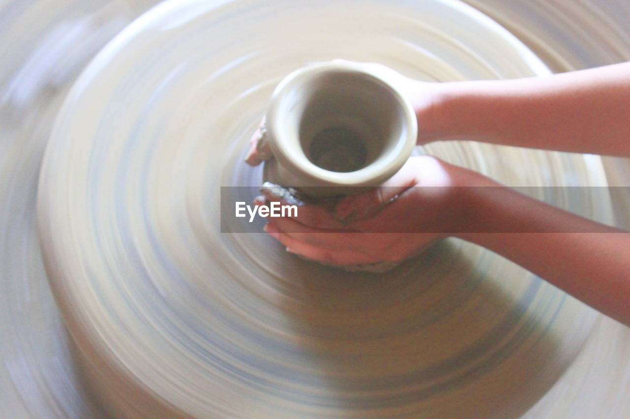 Cropped Hand Of Woman Making Pottery