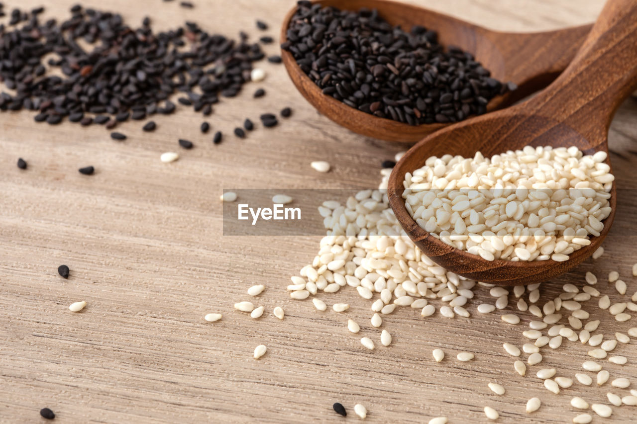 food and drink, food, spoon, wood - material, kitchen utensil, eating utensil, seed, freshness, cereal plant, wooden spoon, household equipment, wellbeing, healthy eating, plant, raw food, no people, ingredient, oats - food, spilling, indoors, breakfast, wood grain, oatmeal