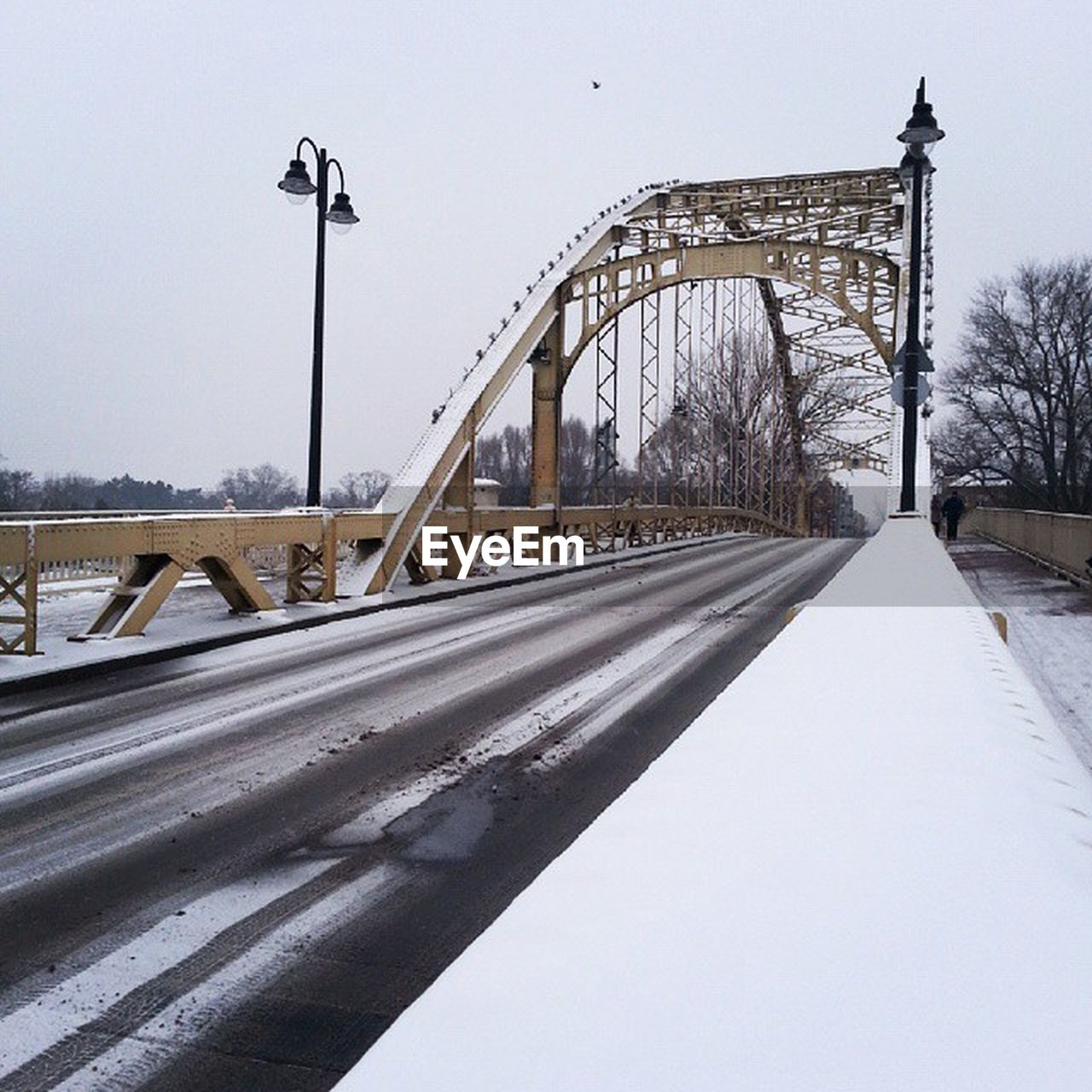 bridge - man made structure, connection, transportation, road, snow, winter, cold temperature, the way forward, built structure, architecture, outdoors, street light, bridge, day, no people, sky, clear sky, city, nature