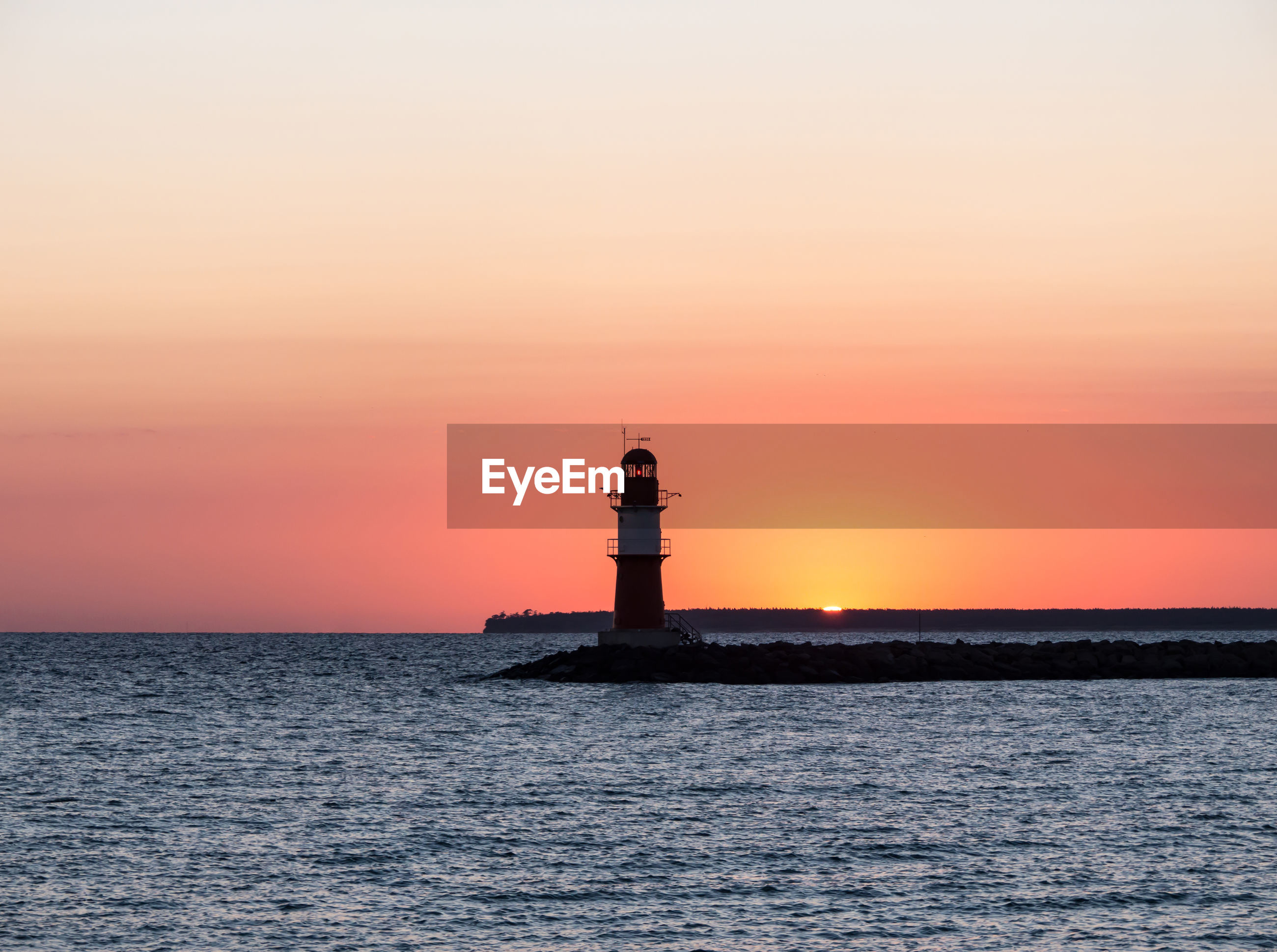 LIGHTHOUSE AGAINST SKY DURING SUNSET