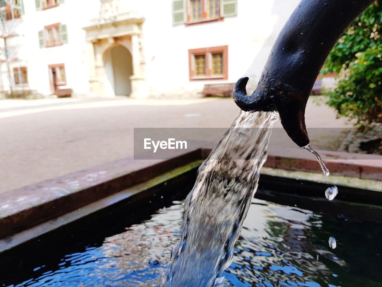 water, fountain, drinking fountain, architecture, day, motion, outdoors, no people, building exterior, running water, waterfront, built structure, tap, dripping, close-up, nature, animal themes