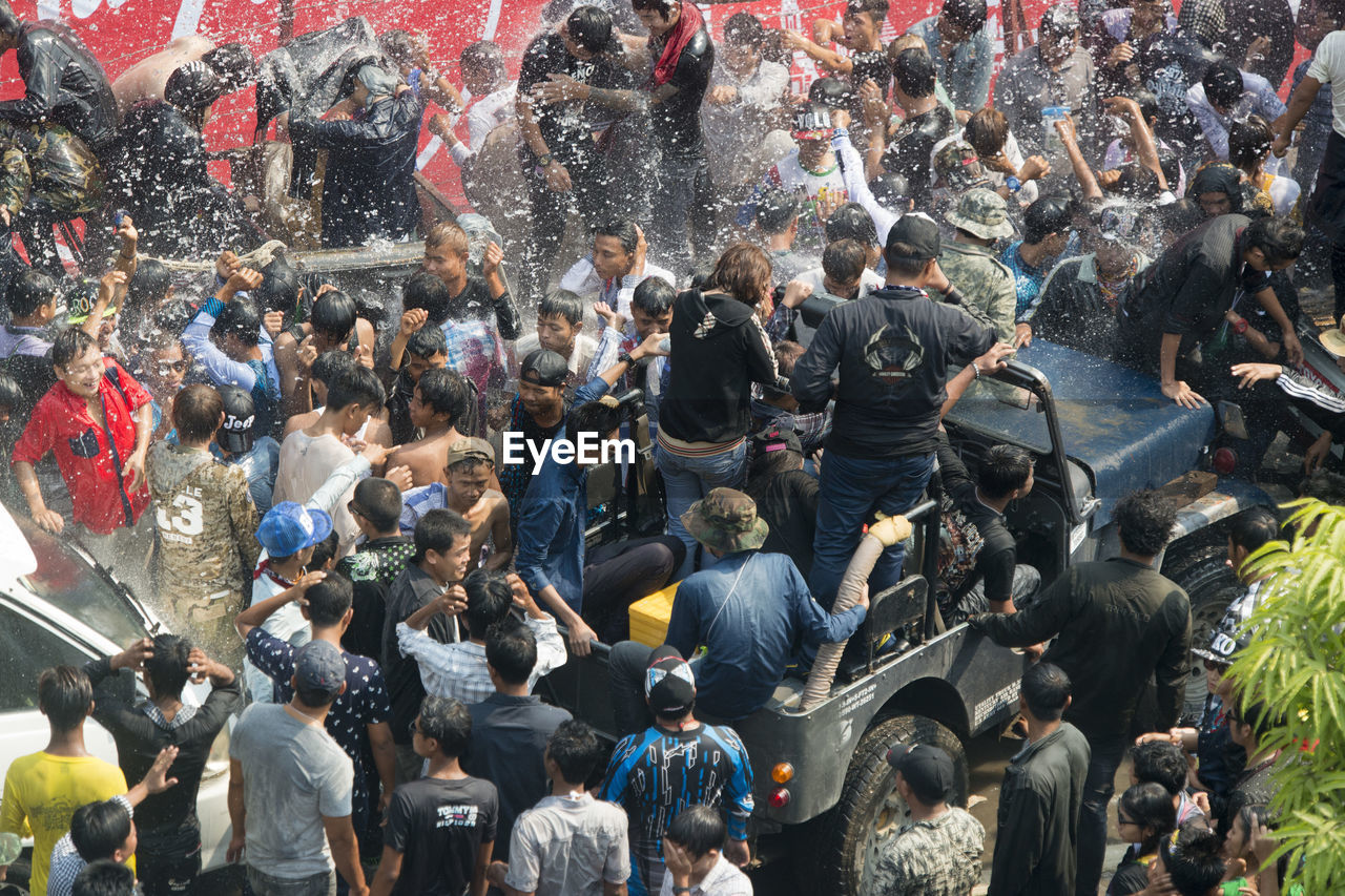 People Enjoying In City During Water Festival