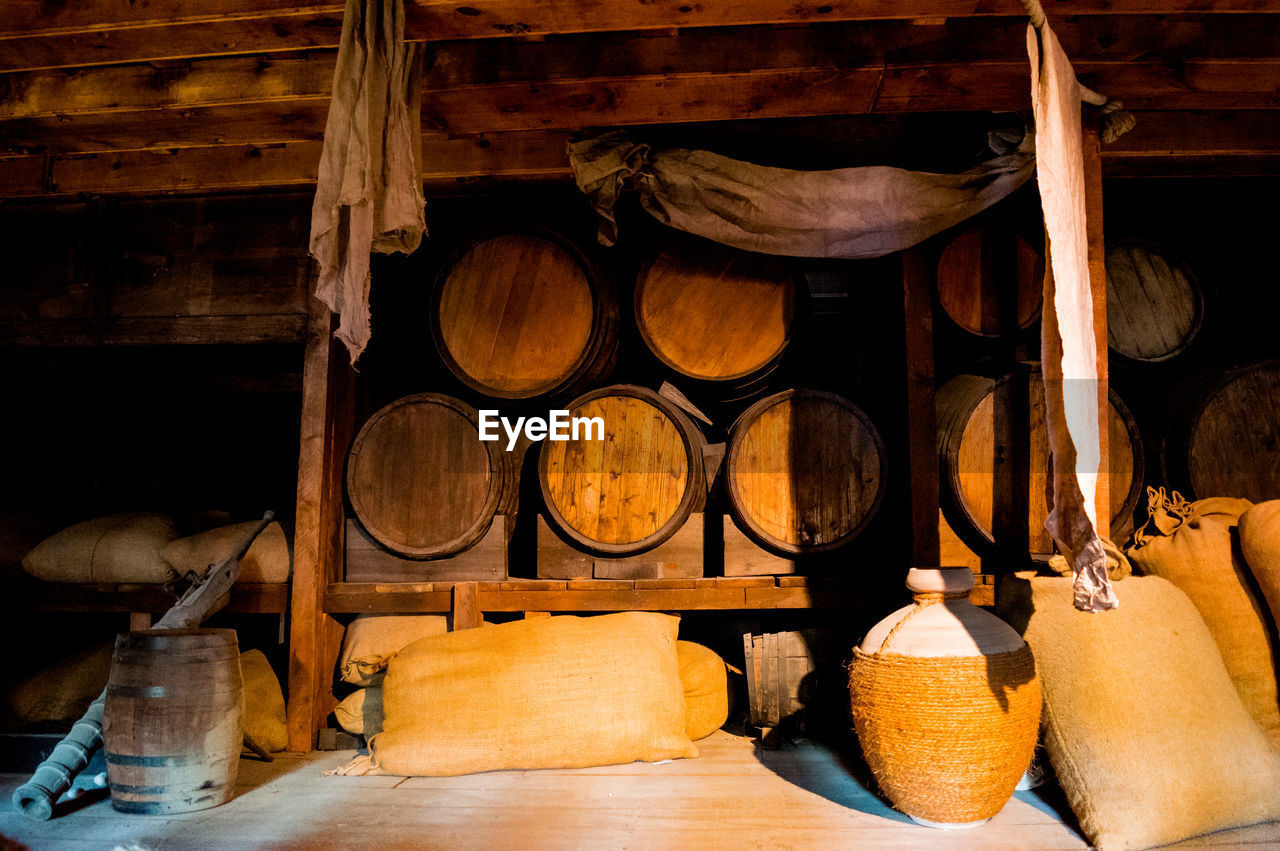 wood - material, indoors, no people, large group of objects, food and drink, business, container, shelf, store, food and drink industry, for sale, cellar, still life, workshop, barrel, stack, wine cask, domestic room, warehouse, wood