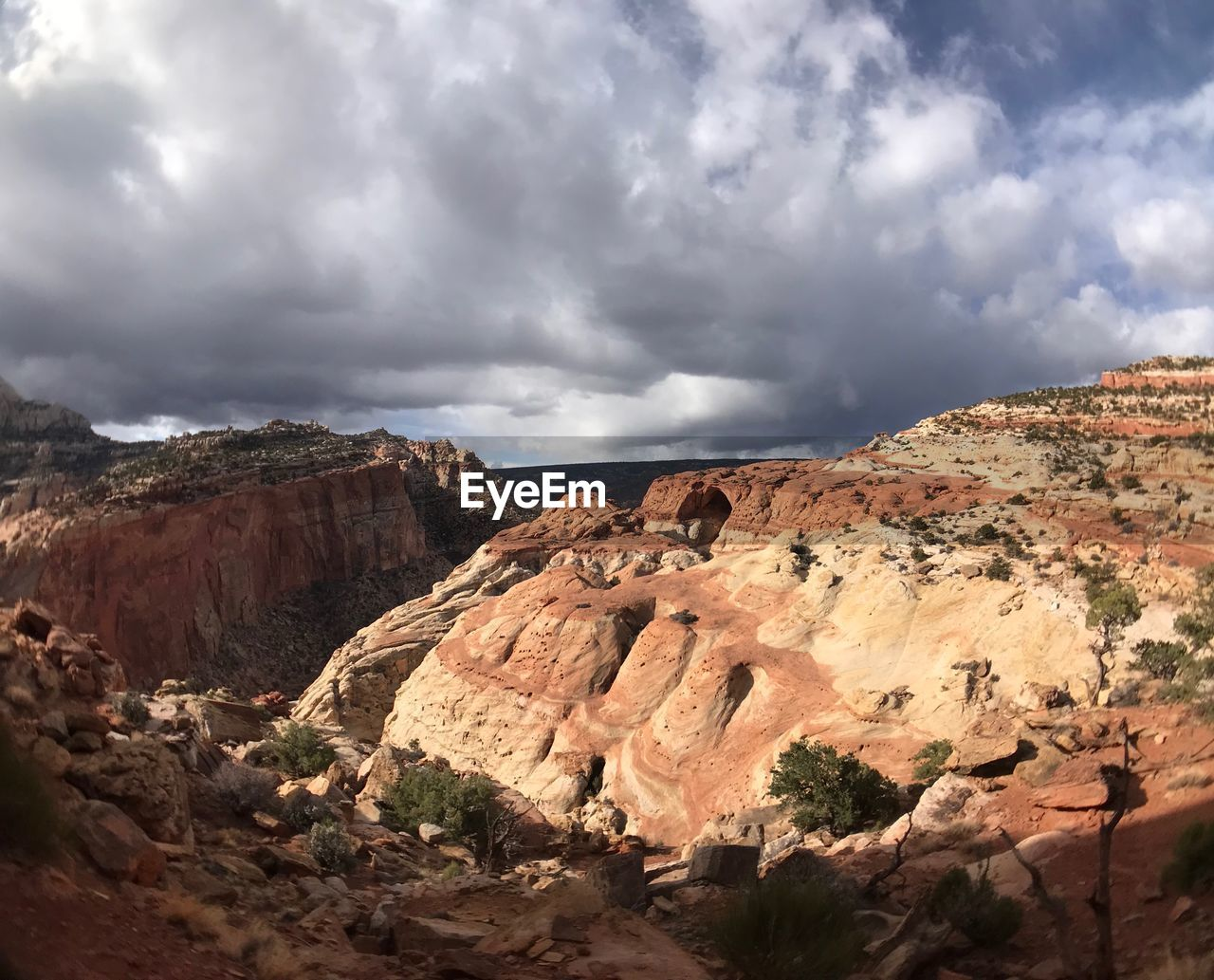 cloud - sky, rock, sky, scenics - nature, rock - object, beauty in nature, solid, tranquil scene, rock formation, environment, non-urban scene, landscape, tranquility, nature, mountain, geology, physical geography, no people, remote, day, formation, mountain range, eroded, arid climate, climate, sandstone