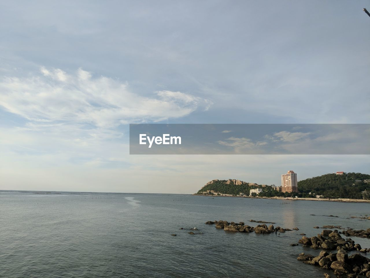 water, sky, sea, architecture, scenics - nature, built structure, cloud - sky, nature, beauty in nature, tranquil scene, tranquility, building exterior, no people, building, land, horizon, rock, waterfront, idyllic, bay