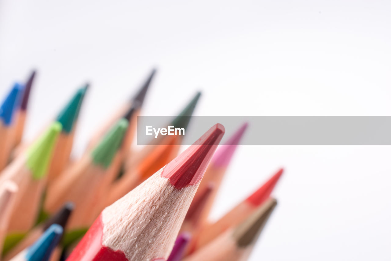 multi colored, variation, still life, pencil, white background, close-up, choice, art and craft, indoors, writing instrument, studio shot, colored pencil, no people, craft, selective focus, large group of objects, copy space, in a row, collection, art and craft equipment