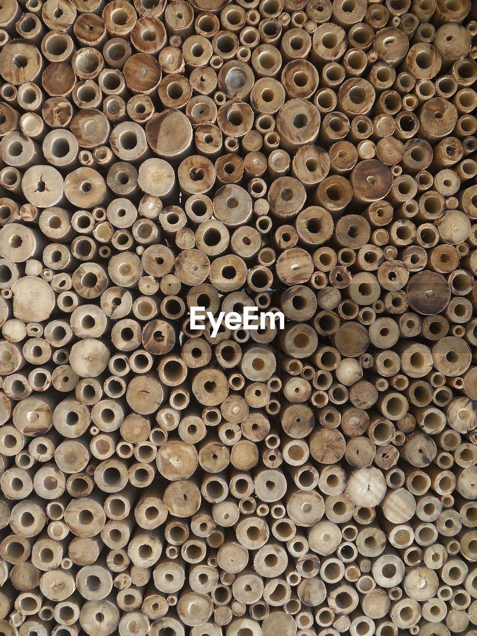 Full frame shot of stack of wood