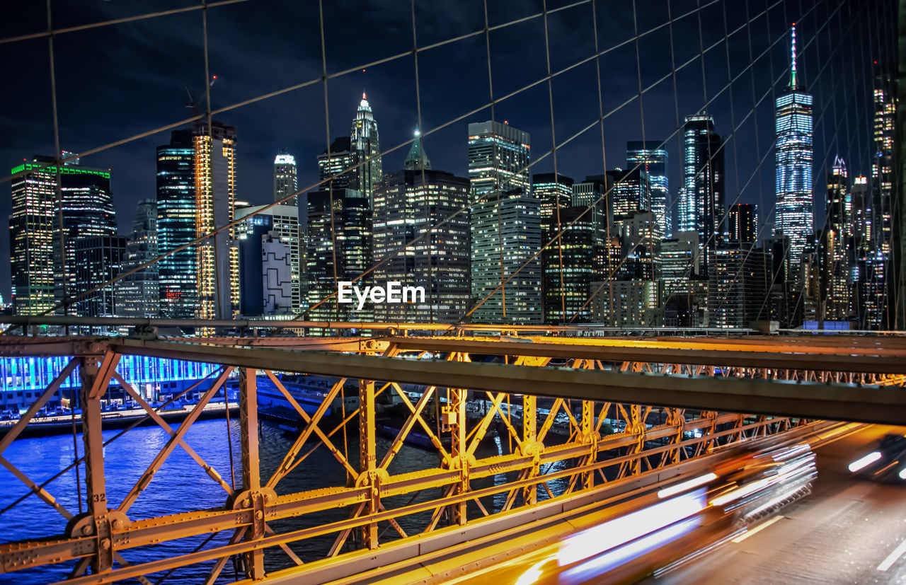 architecture, built structure, building exterior, city, connection, night, office building exterior, building, bridge, skyscraper, bridge - man made structure, illuminated, transportation, modern, tall - high, cityscape, motion, no people, long exposure, outdoors, financial district