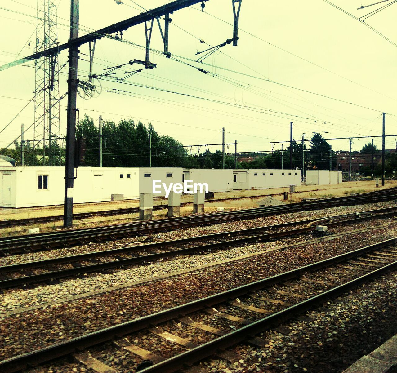 railroad track, rail transportation, cable, transportation, power line, electricity pylon, power supply, railway track, no people, electricity, railroad station platform, day, outdoors, railway, sky