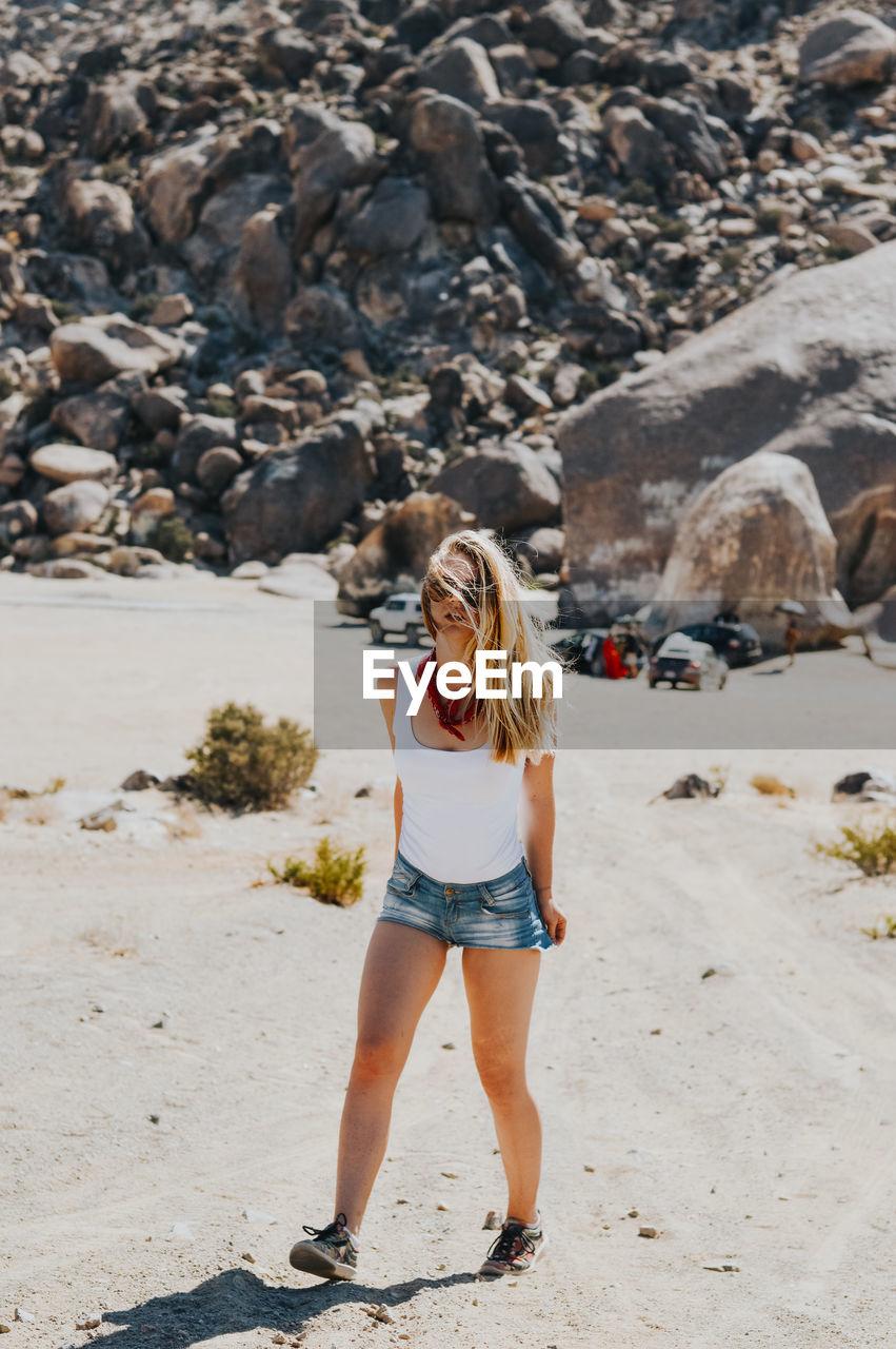 Full length of woman walking at beach