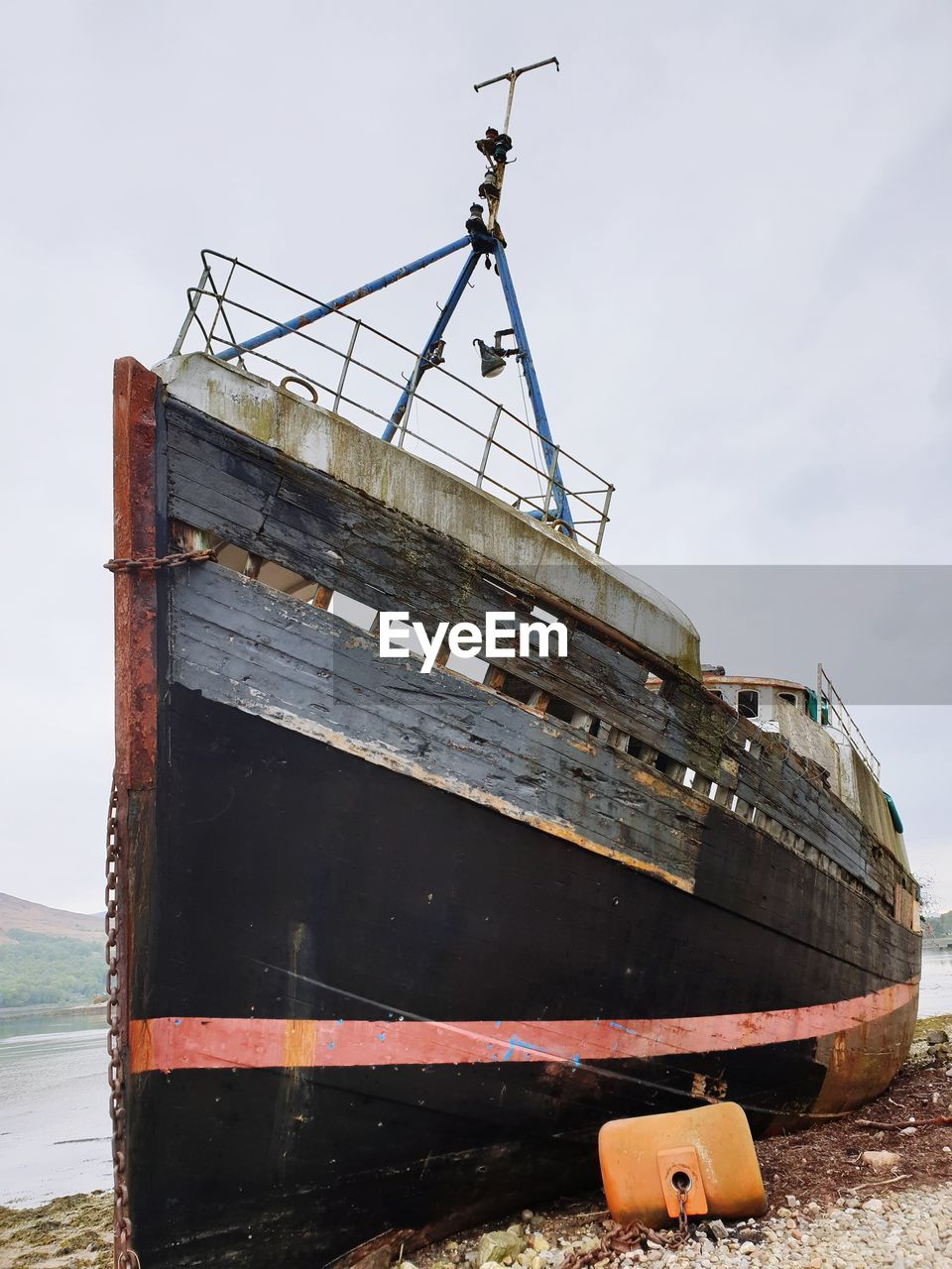 ABANDONED SHIP MOORED IN WATER