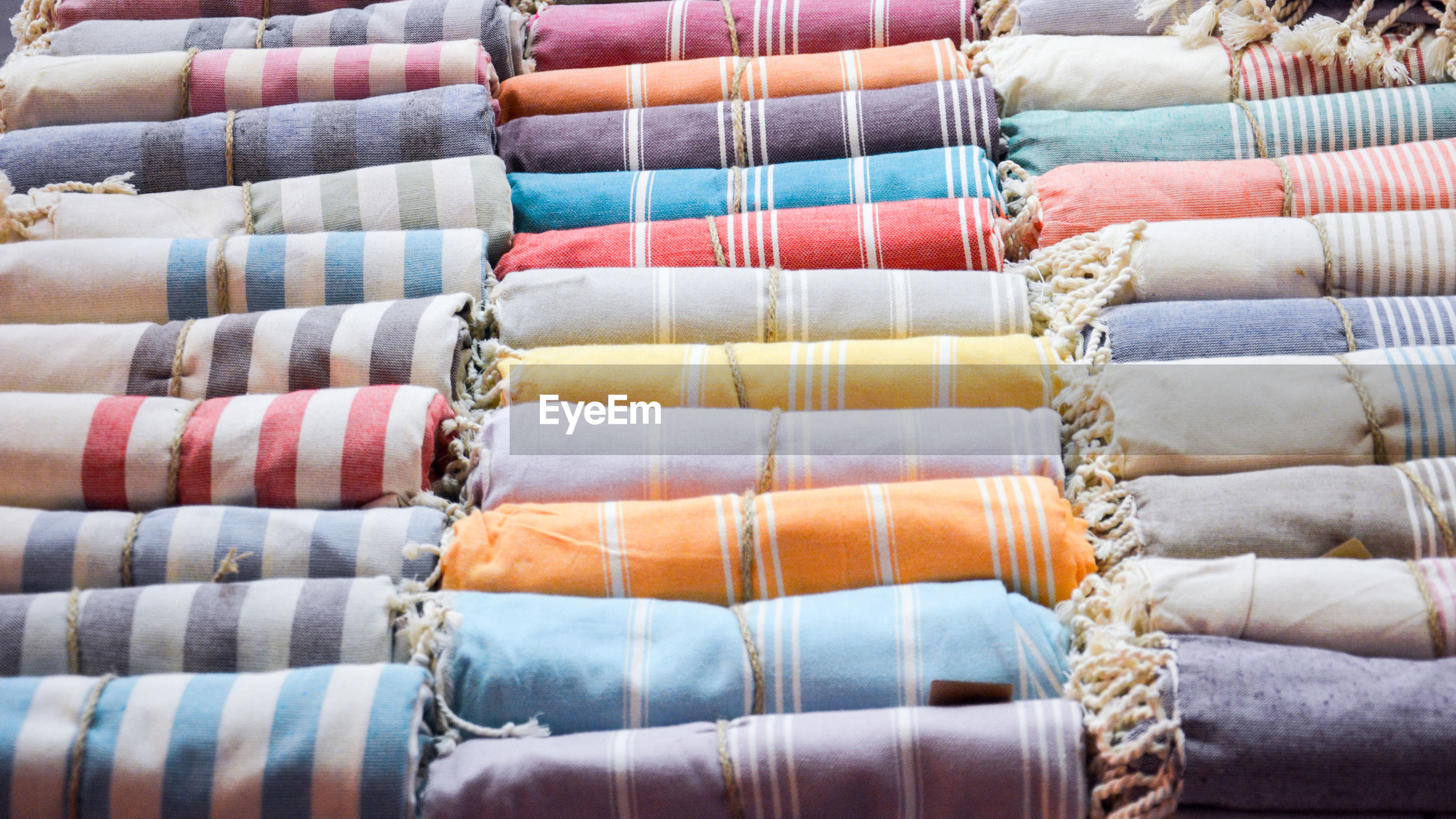 Full frame shot of rolled up fabrics at store