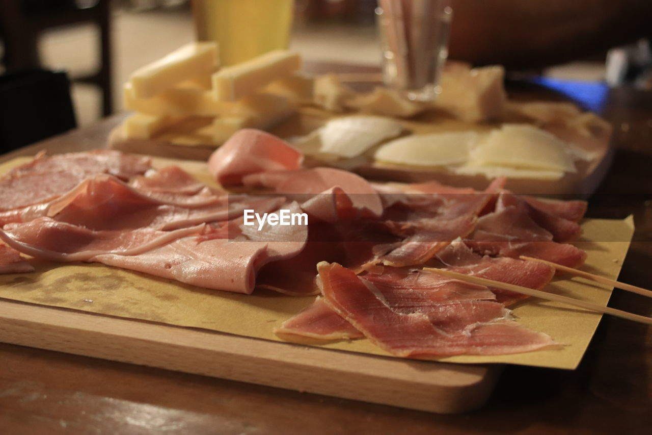 meat, food and drink, food, freshness, pork, ham, processed meat, indoors, raw food, table, still life, close-up, slice, no people, healthy eating, prosciutto, cutting board, wellbeing, bacon, dairy product, tray, preparing food, snack