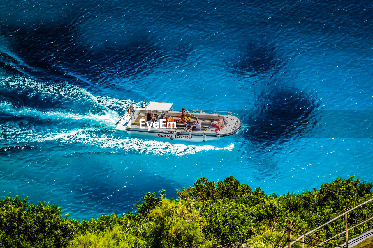 High angle view of motorboat sailing in blue sea