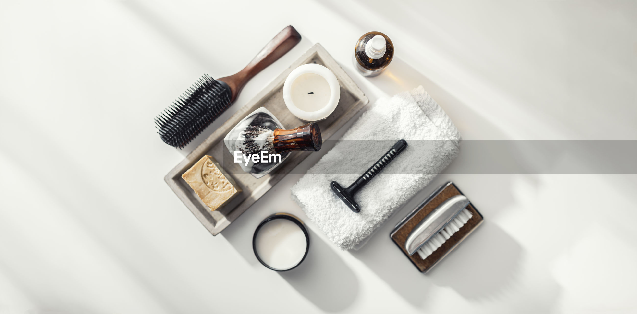 Directly above shot of shaving equipment over white background