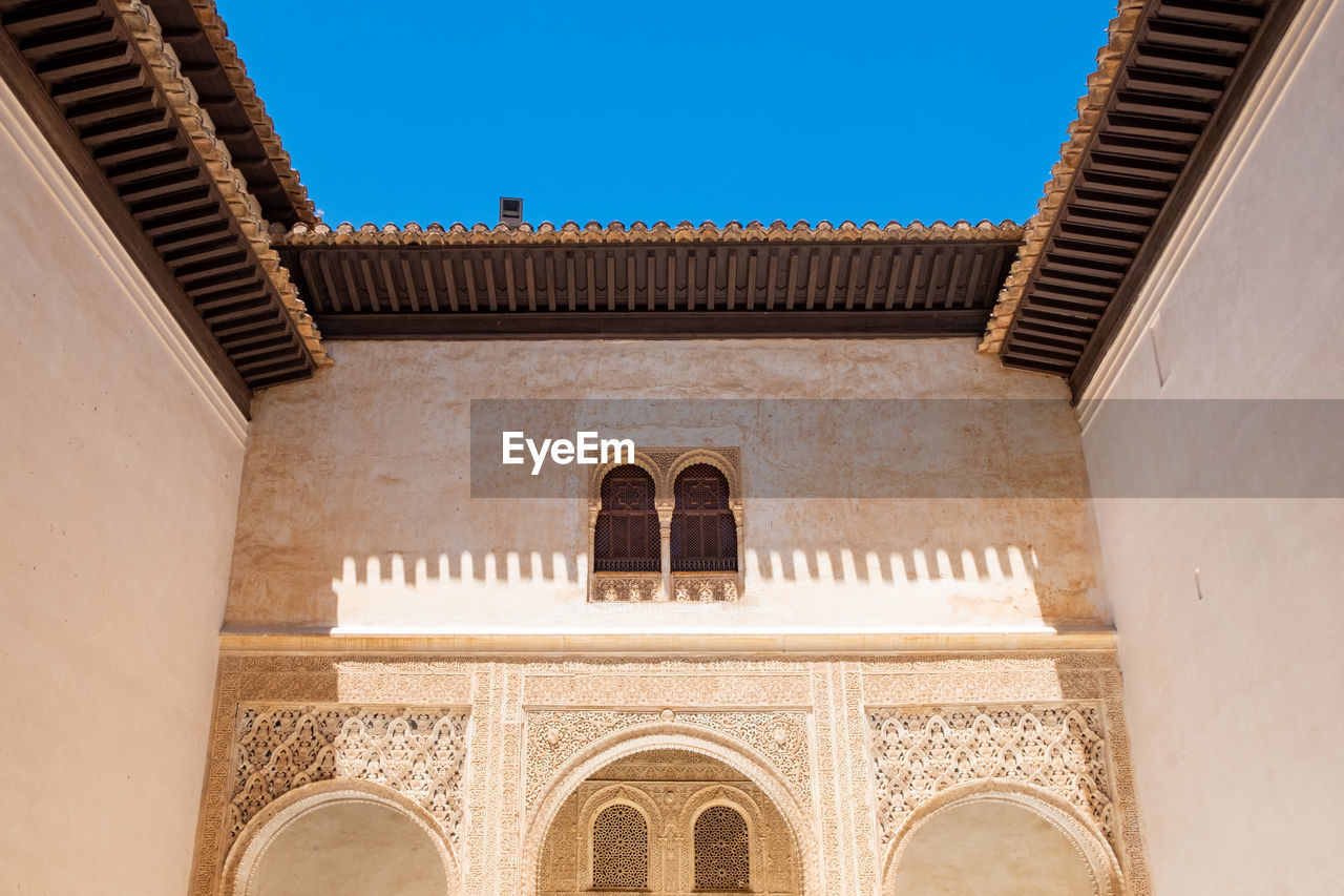 architecture, built structure, building exterior, arch, sky, building, clear sky, low angle view, travel destinations, day, no people, the past, history, nature, sunlight, window, tourism, outdoors, religion, travel, ornate, courtyard, classical style