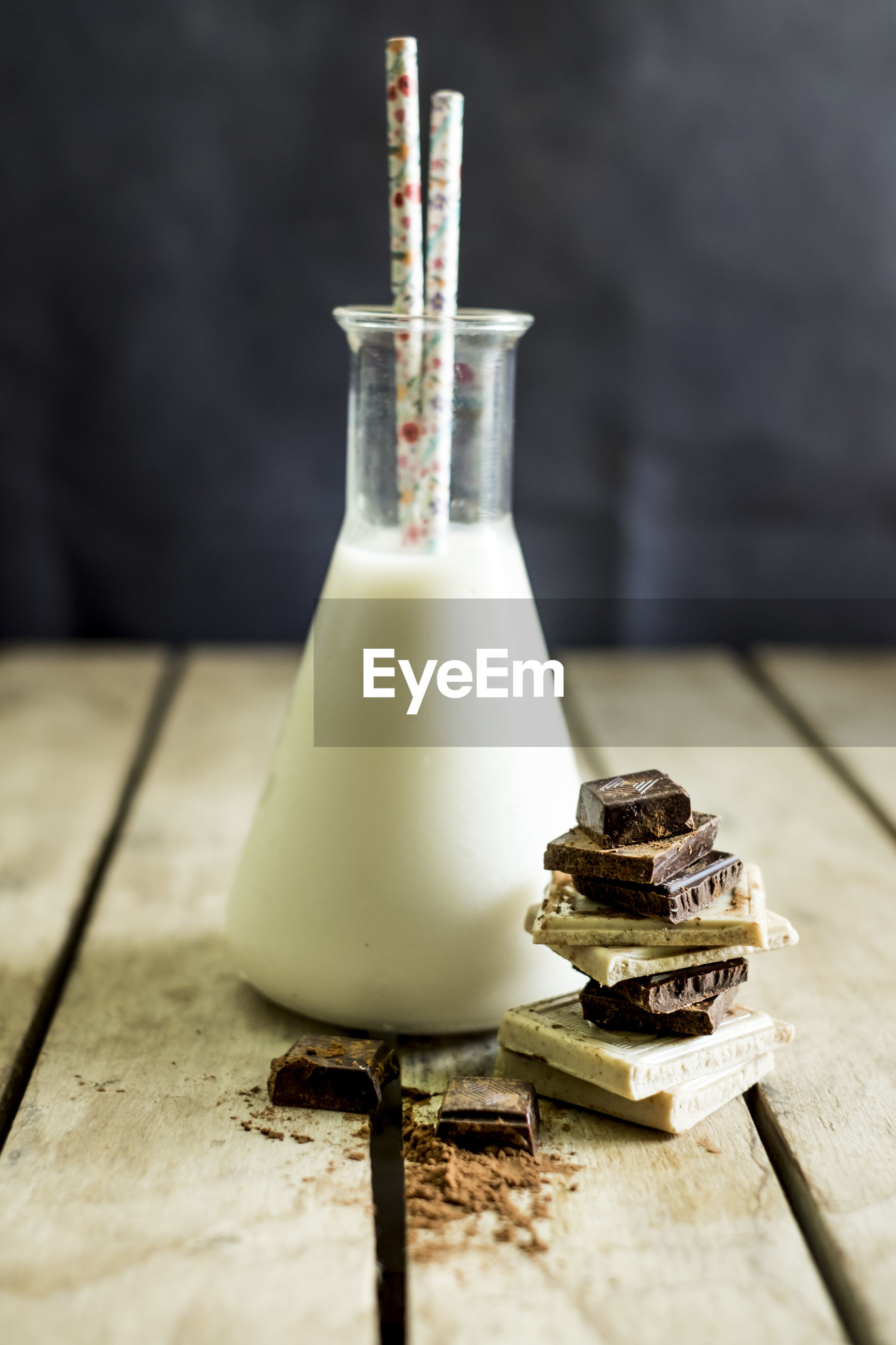 Close-up of chocolate and milk on table