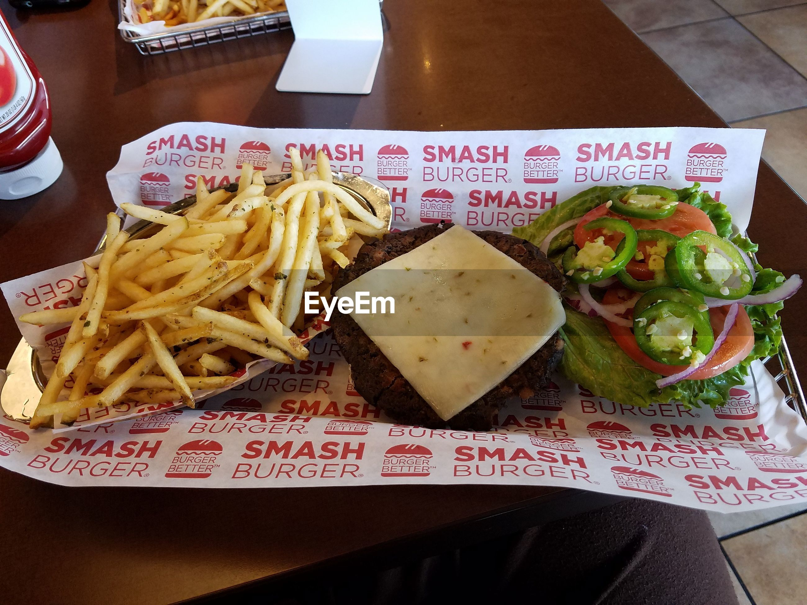 food and drink, food, indoors, freshness, ready-to-eat, plate, table, still life, french fries, healthy eating, serving size, close-up, meal, high angle view, indulgence, meat, restaurant, seafood, text, sauce
