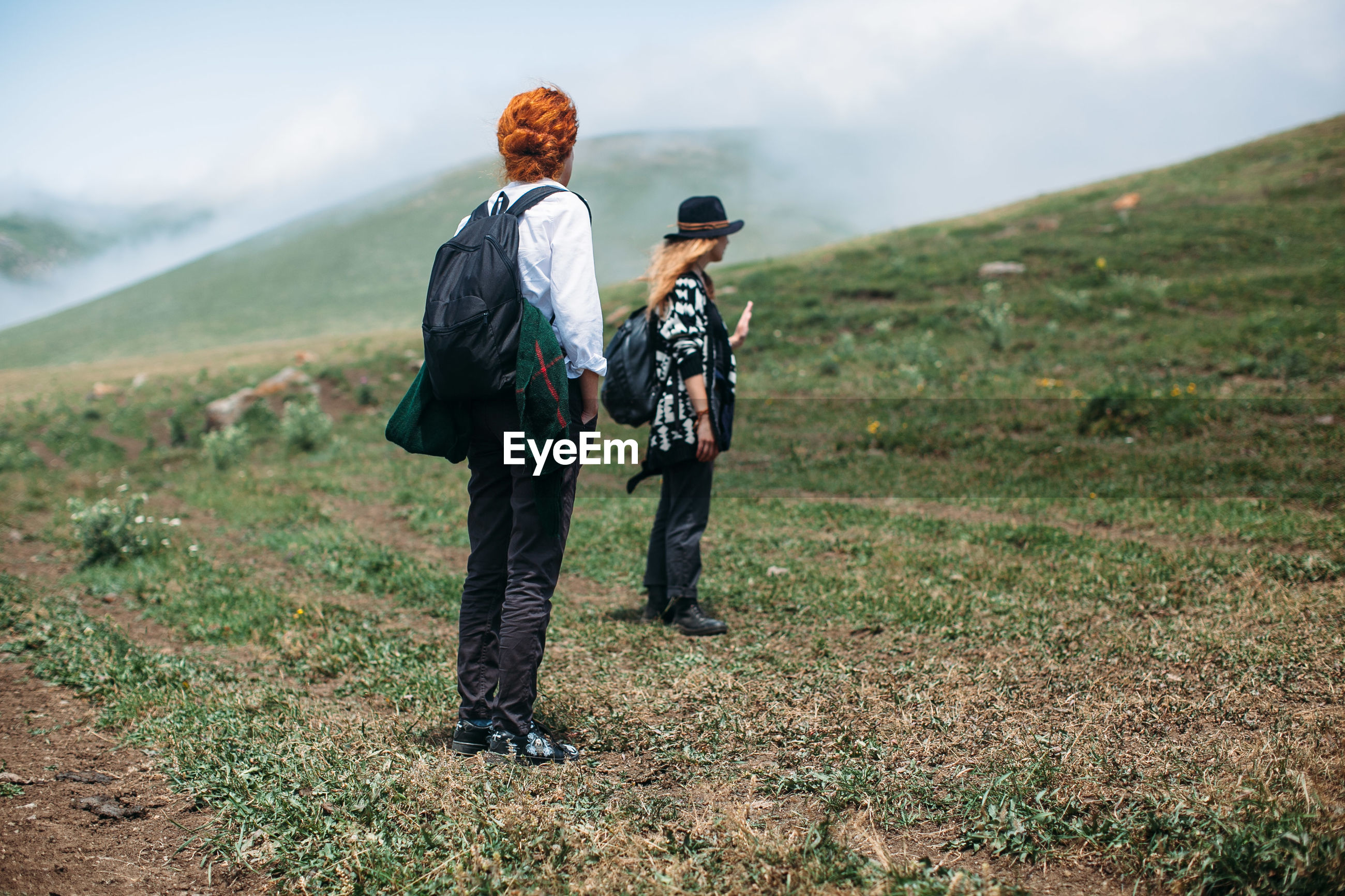 Rear view of two women on field