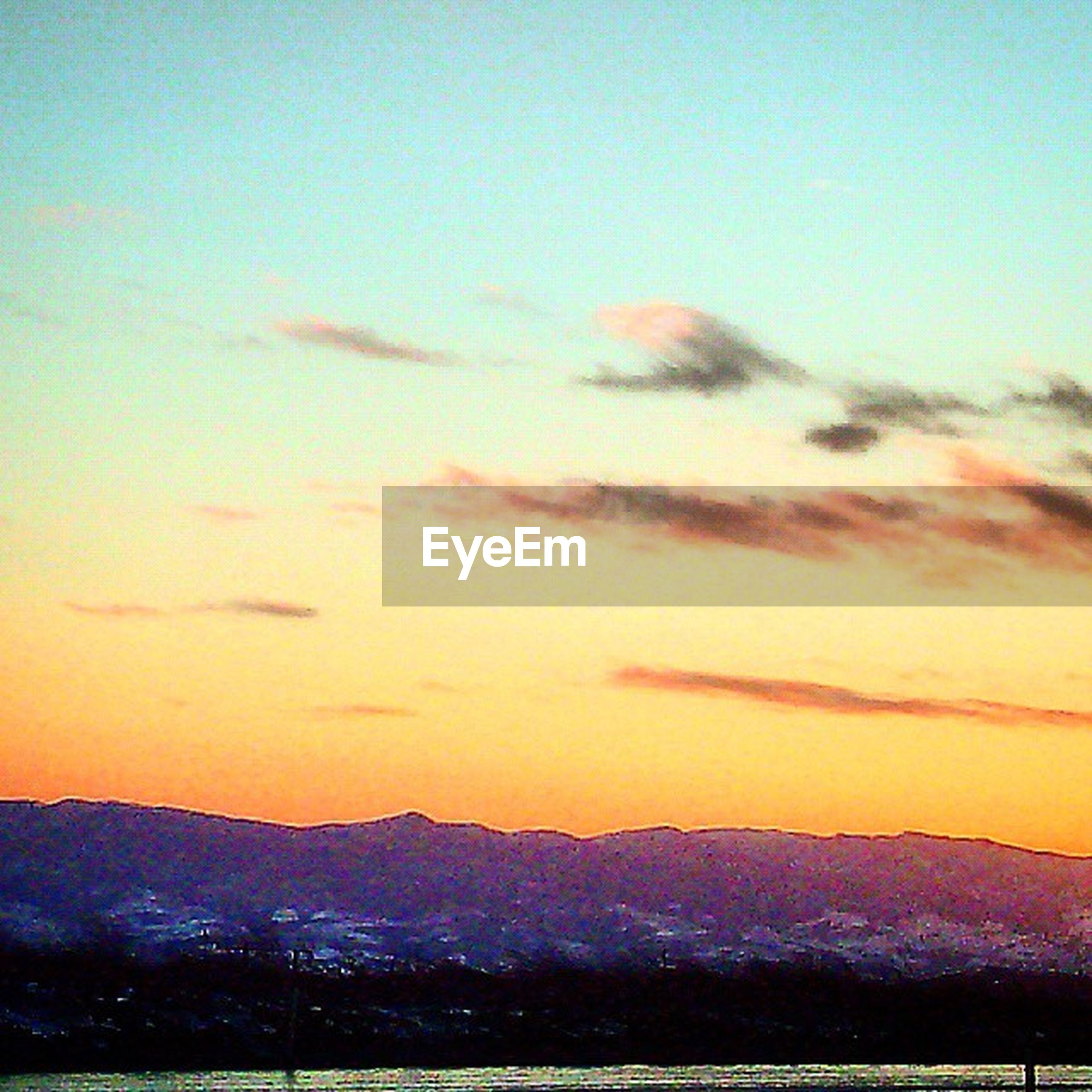 snow, winter, sunset, cold temperature, scenics, sky, beauty in nature, mountain, tranquil scene, landscape, tranquility, orange color, nature, season, cloud - sky, weather, covering, idyllic, mountain range, building exterior