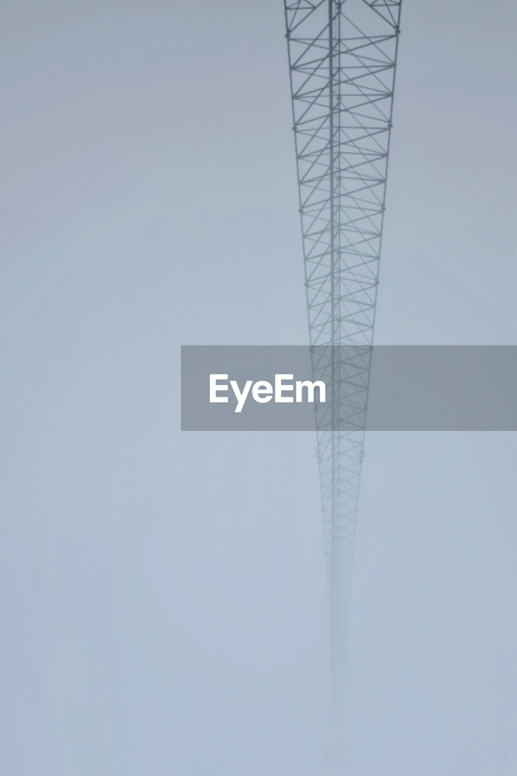 Low angle view of tower in foggy weather