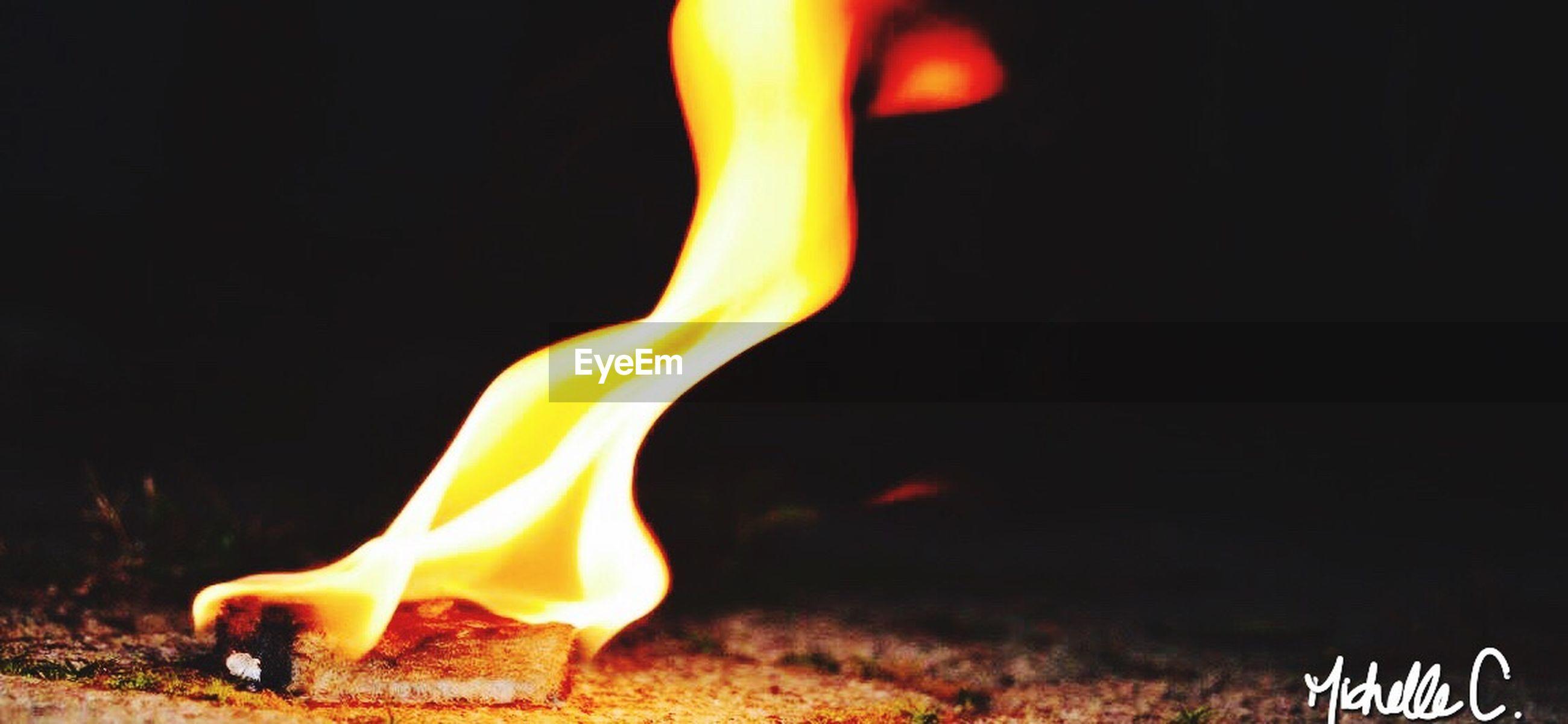 burning, flame, fire - natural phenomenon, heat - temperature, night, glowing, fire, black background, close-up, bonfire, dark, copy space, illuminated, studio shot, yellow, motion, light - natural phenomenon, heat, campfire, no people