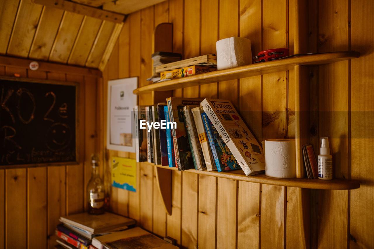 BOOKS ON SHELF IN HOME