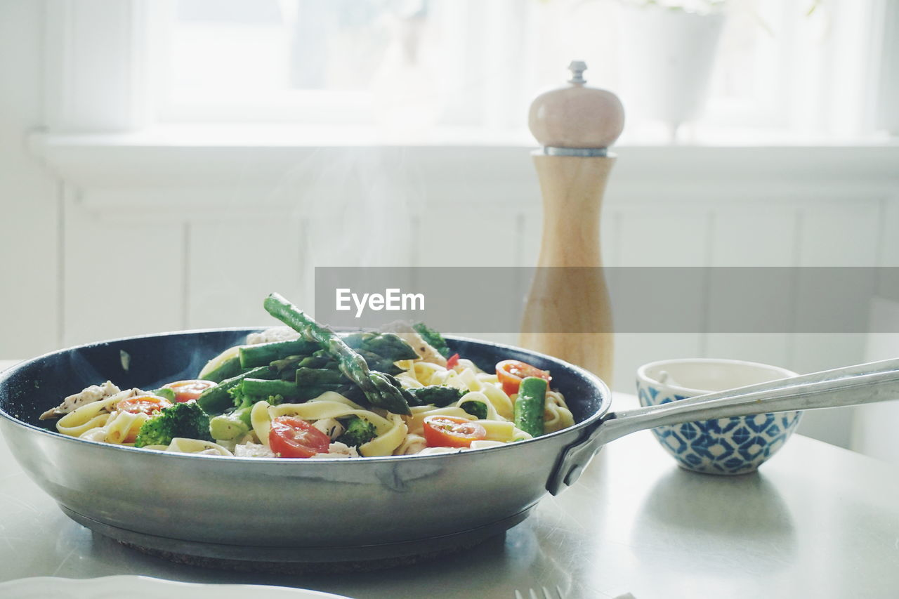 Close-Up Of Pasta In Cooking Pan On Table