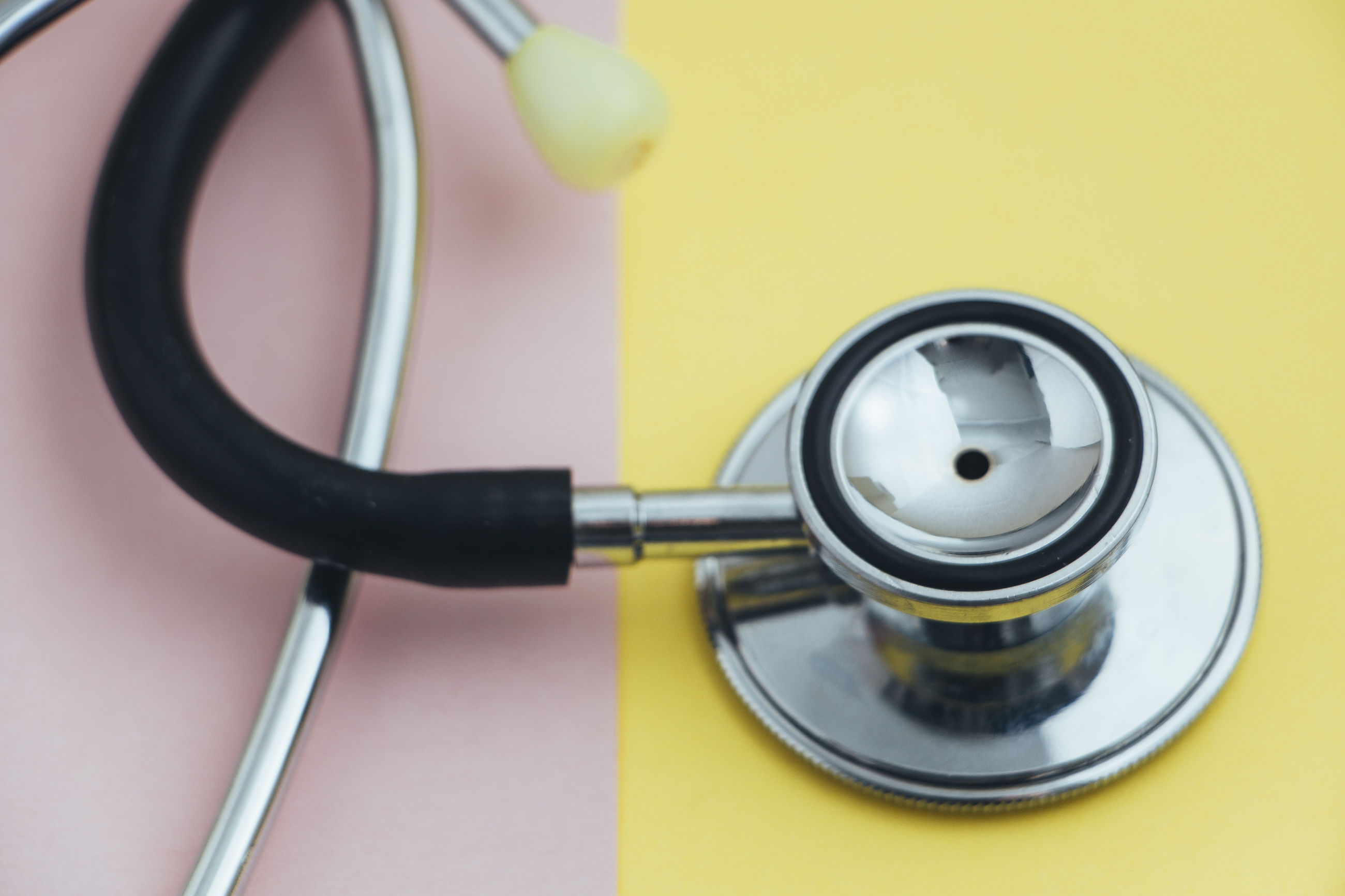 Close-up of stethoscope against colored background