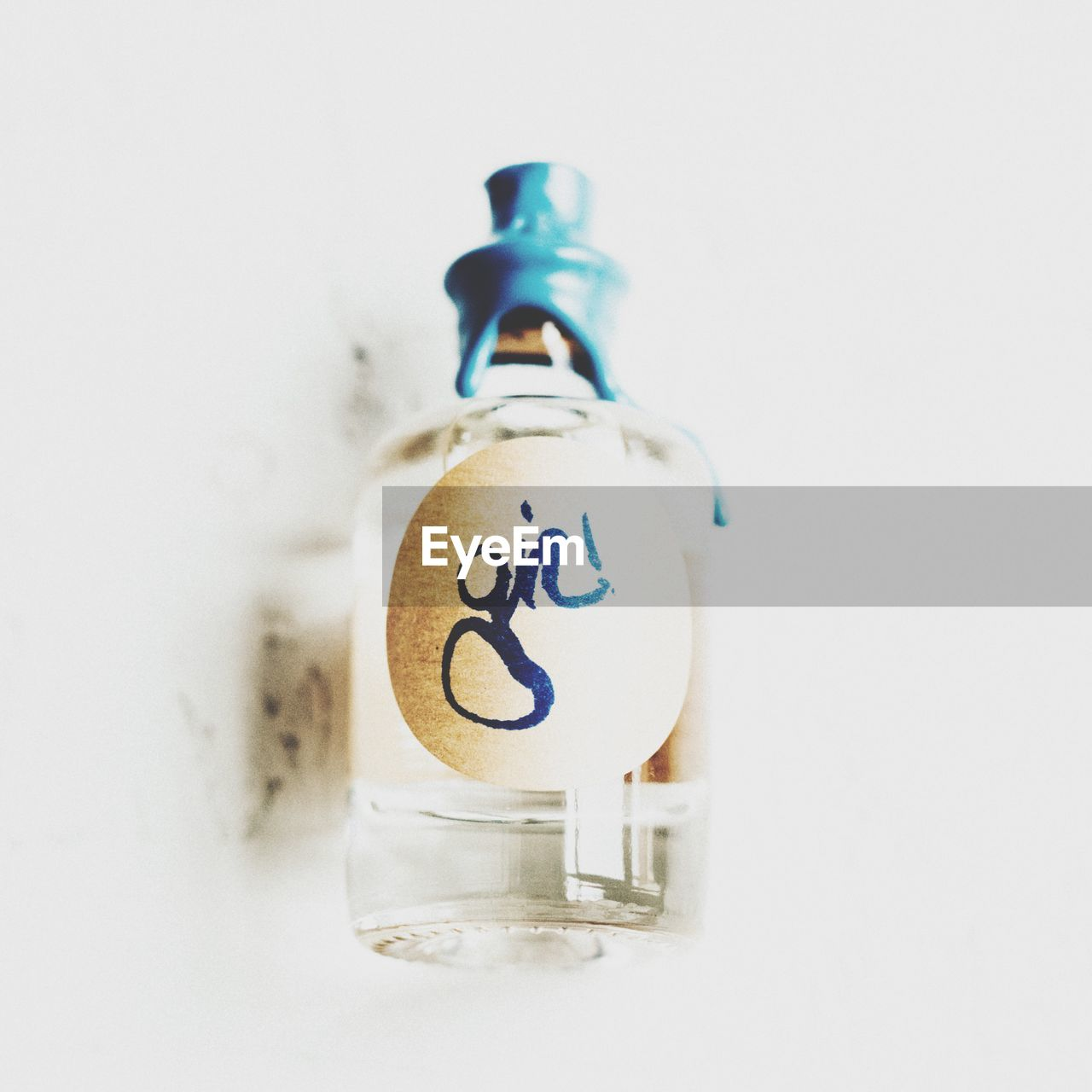 white background, no people, studio shot, indoors, bottle, close-up, day