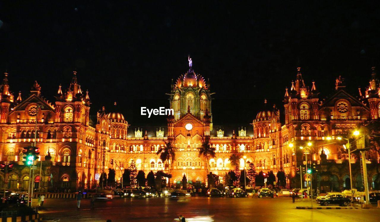Illuminated Chhatrapati Shivaji Terminus Railway Station Against Sky In City At Night