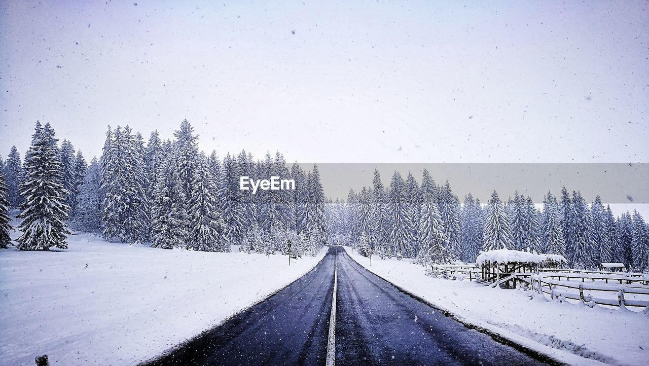 Snow Covered Road Against Clear Sky During Winter