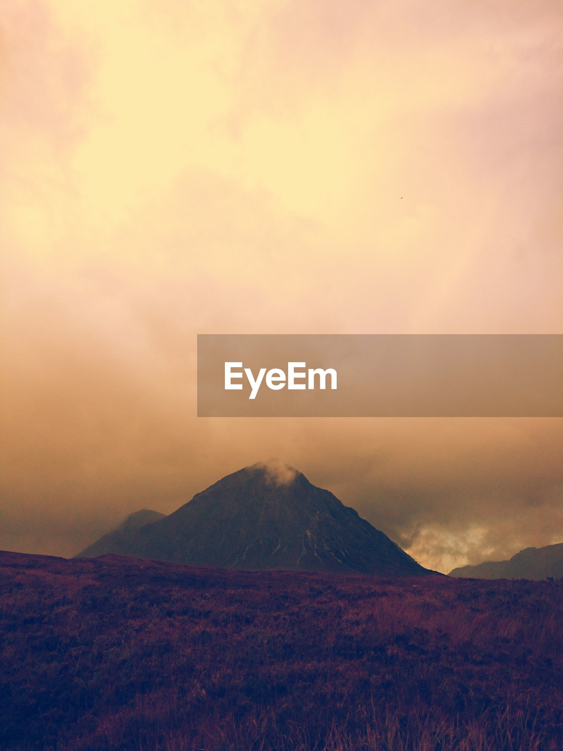 tranquil scene, scenics, tranquility, mountain, landscape, beauty in nature, sky, mountain range, nature, sunset, cloud - sky, idyllic, non-urban scene, cloudy, remote, weather, cloud, dusk, horizon over land, outdoors