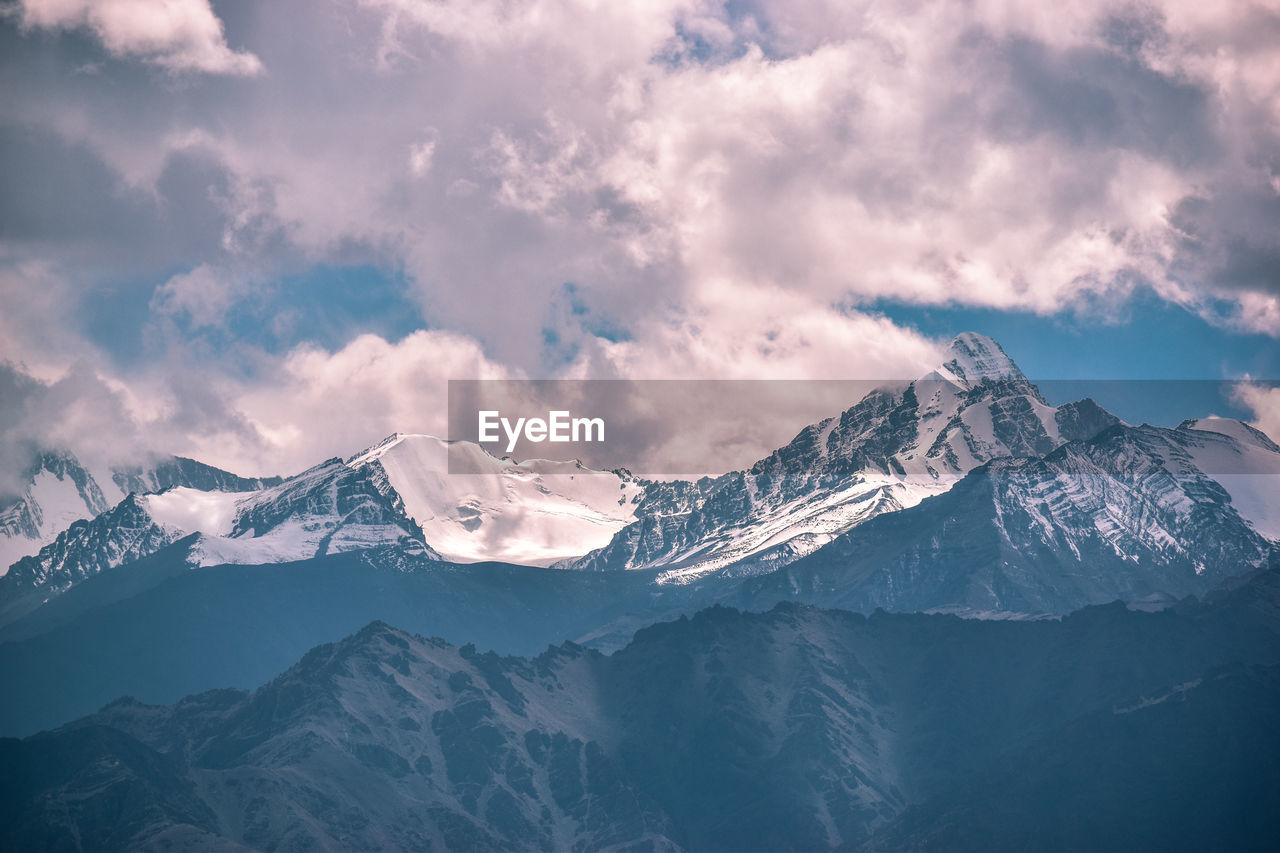 mountain, cold temperature, scenics - nature, beauty in nature, cloud - sky, winter, sky, snow, mountain range, tranquil scene, tranquility, snowcapped mountain, non-urban scene, environment, nature, mountain peak, landscape, idyllic, no people, outdoors, formation