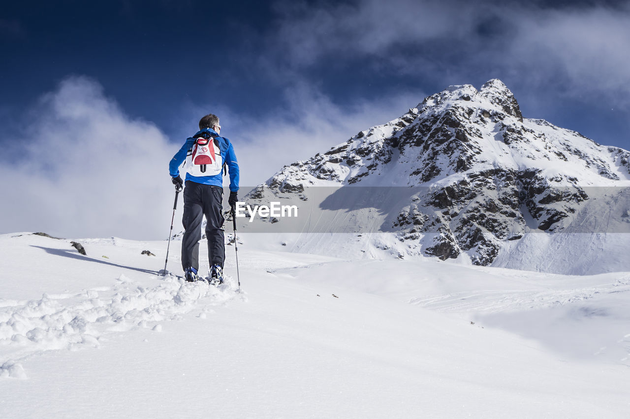 Full Length Of Man Standing On Snow Covered Landscape