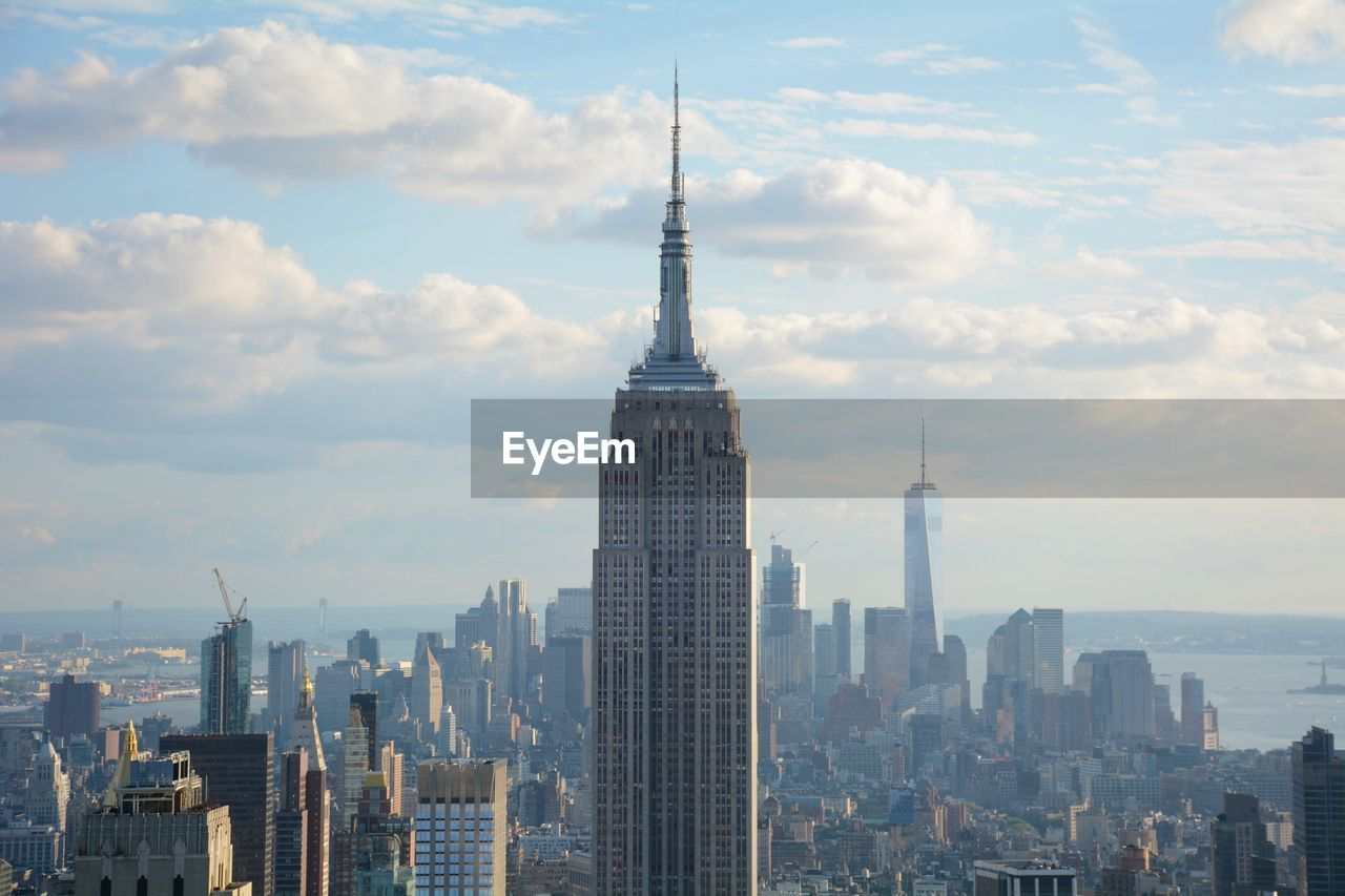 Empire State Building Against Modern Towers At Manhattan