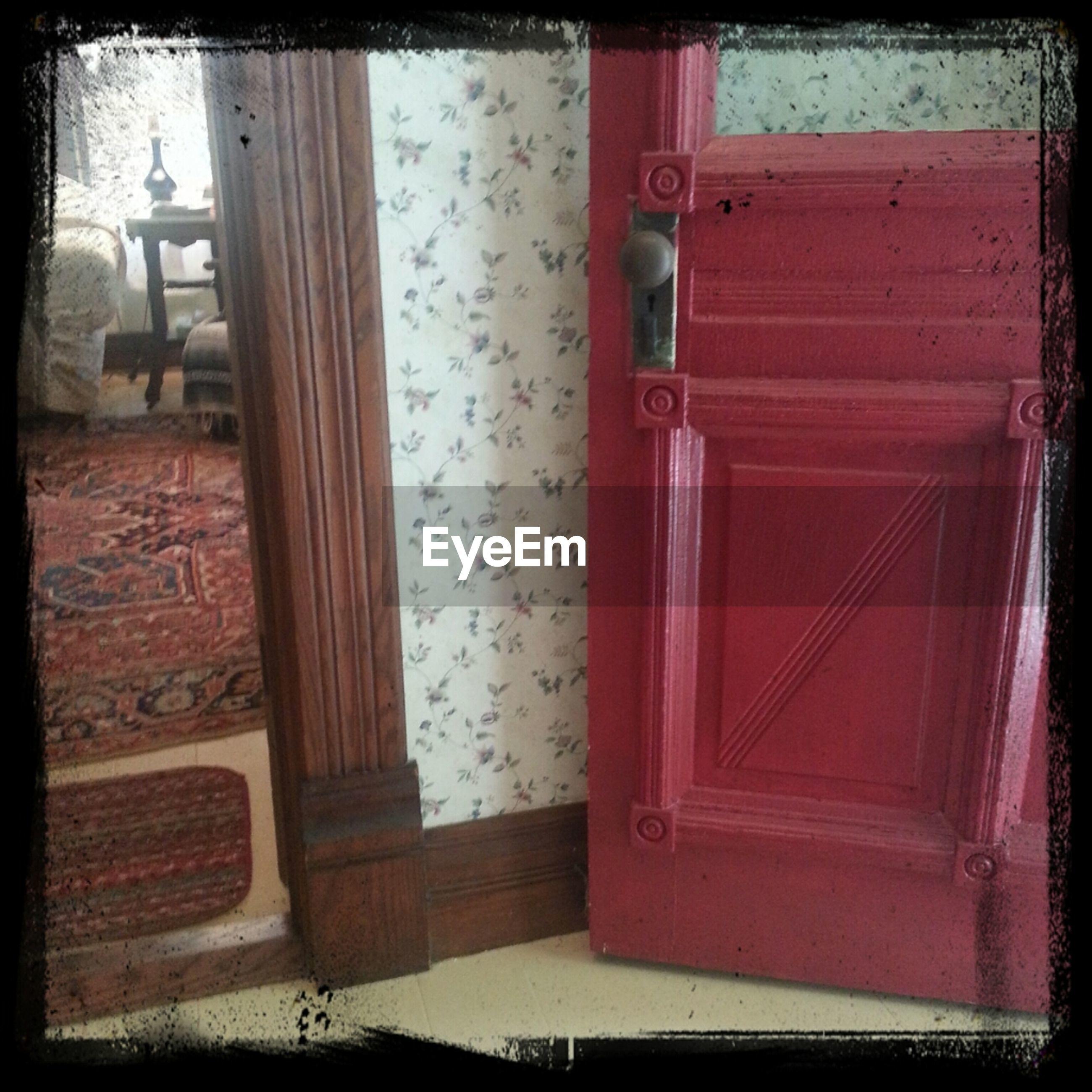 Cropped image of open door of house